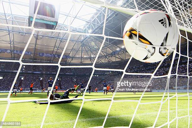 Konstantin Rausch of Darmstadt shoots on goal and scores past Goalkeeper Ralf Fahrmann of Schalke during the Bundesliga match between FC Schalke 04...