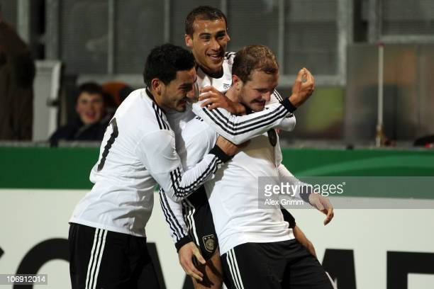 Konstantin Rausch of Germany celebrates his team's first goal with team mates Cenk Torsun and Ilkay Guendogan during the U21 international friendly...