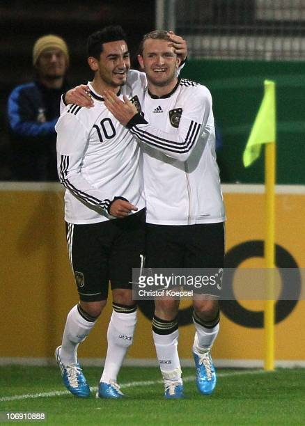 Konstantin Rausch of Germany celebrates the first goal with Ilkay Guendogan of Germany during the U21 international friendly match between Germany...