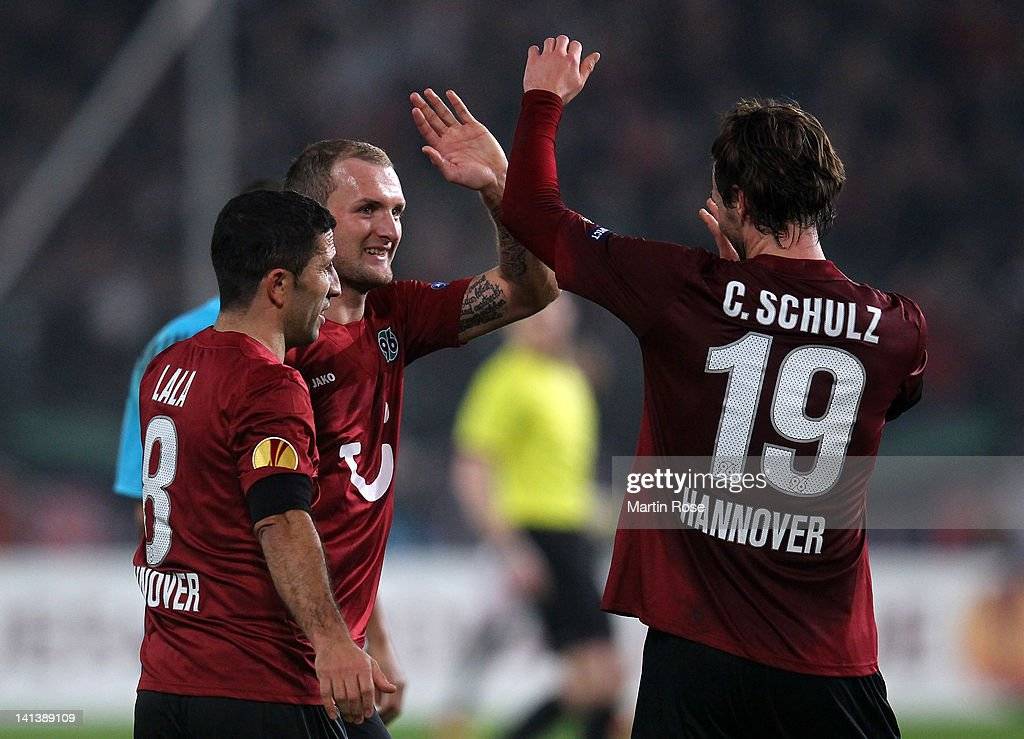 Konstantin Rausch of Hannover celebrate with his team mates after the UEFA Europa League second leg round of 16 match between Hannover 96 and...