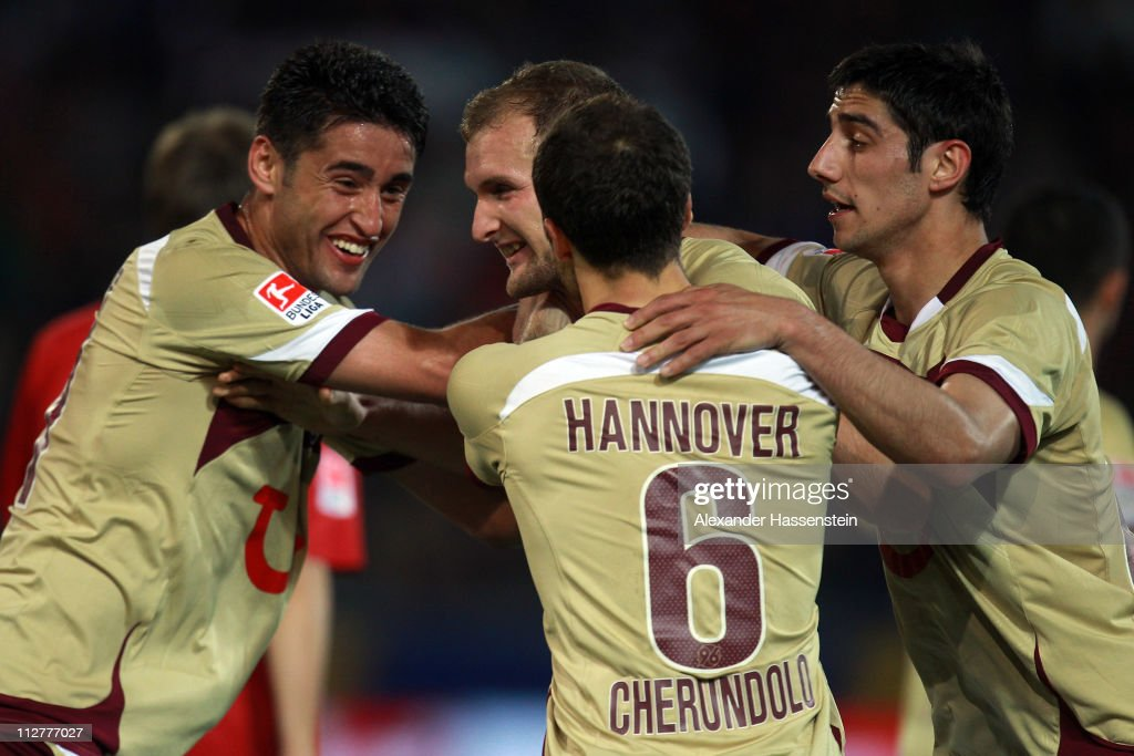 Konstantin Rausch of Hannover celebrates scoring the 3rd team goal with his team mates Lars Stindl Steven Cherundolo and Karim Haggui during the...