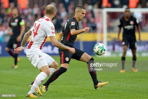 Konstantin Rausch of Koeln and Mijat Gacinovic of Frankfurt battle for the ball during the Bundesliga match between 1 FC Koeln and Eintracht...
