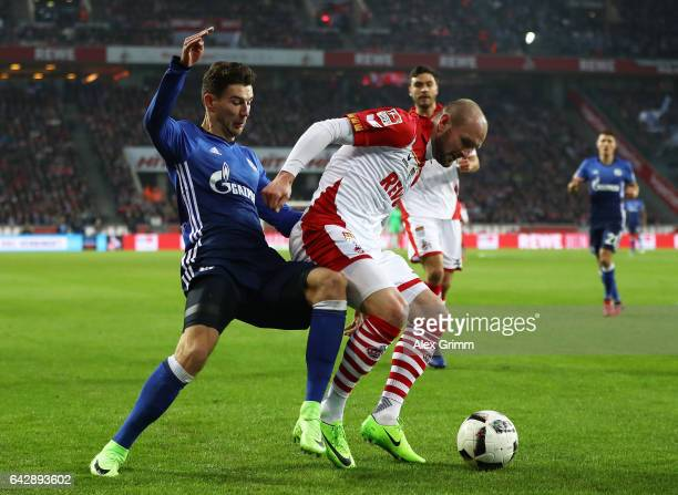Konstantin Rausch of Koeln is challenged by Leon Goretzka of Schalke during the Bundesliga match between 1 FC Koeln and FC Schalke 04 at...