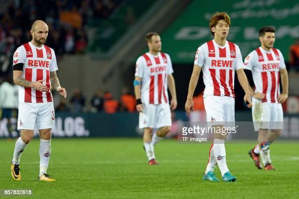 Konstantin Rausch of Koeln Matthias Lehmann of Koeln Yuya Osako of Koeln Milos Jojic of Koeln looks dejected during the Bundesliga match between 1 FC...
