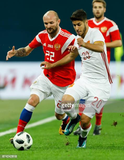 Konstantin Rausch of Russia and Marco Asensio of Spain vie for the ball during Russia and Spain International friendly match on November 14 2017 at...
