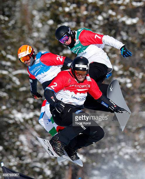 Konstantin Schad of Great Britain flies through the air in front of Jarryd Hughes of Australia and Tommaso Leoni of Italy in the men's quarterfinals...