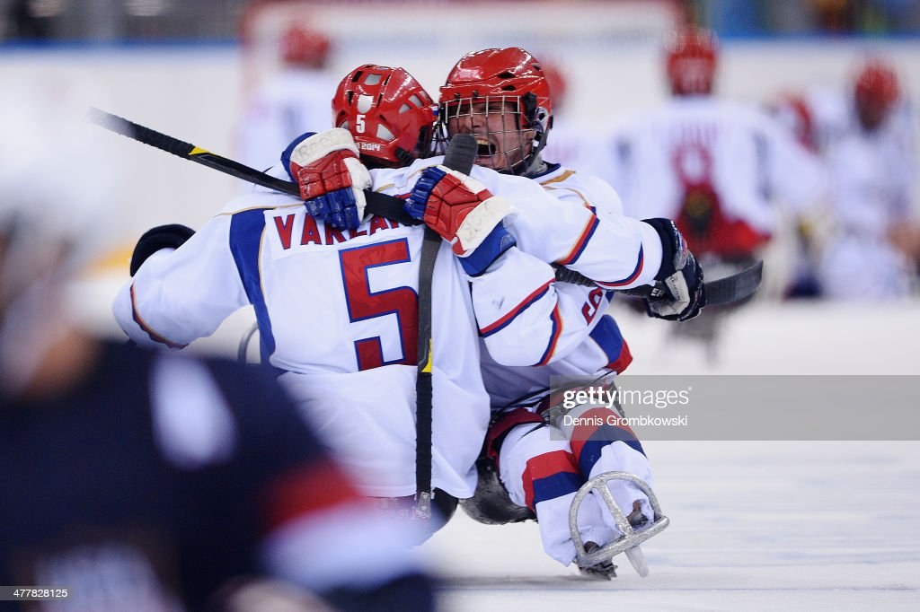 Konstantin Shikhov of Russia celebrates with team mate Vasilii Varlakov after the Ice Sledge Hockey Preliminary Round Group B match between the United States of America and Russia during day four of Sochi 2014 Paralympic Winter Games at Shayba Arena on March 11, 2014 in Sochi, Russia.