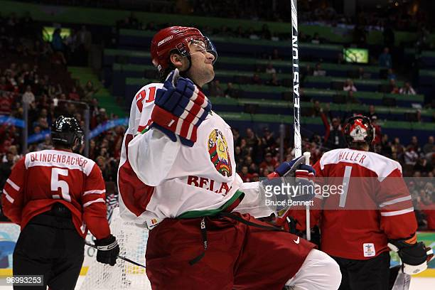 Konstantin Zakharov of Belarus celebrates his secondperiod power play goal against Jonas Hiller of Switzerland during the ice hockey Men's...