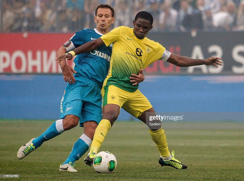 Konstantin Zyryanov of FC Zenit St Petersburg and Samuel Eto'o of FC Anji Makhachkala vie for the ball during the Russian Premier League match...