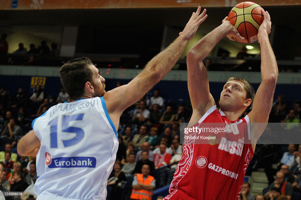 Konstantinos Kaimakoglou of Greece defends against Victor Khryapa of Russia during the EuroBasket 2011 second round match between Greece and Russia...