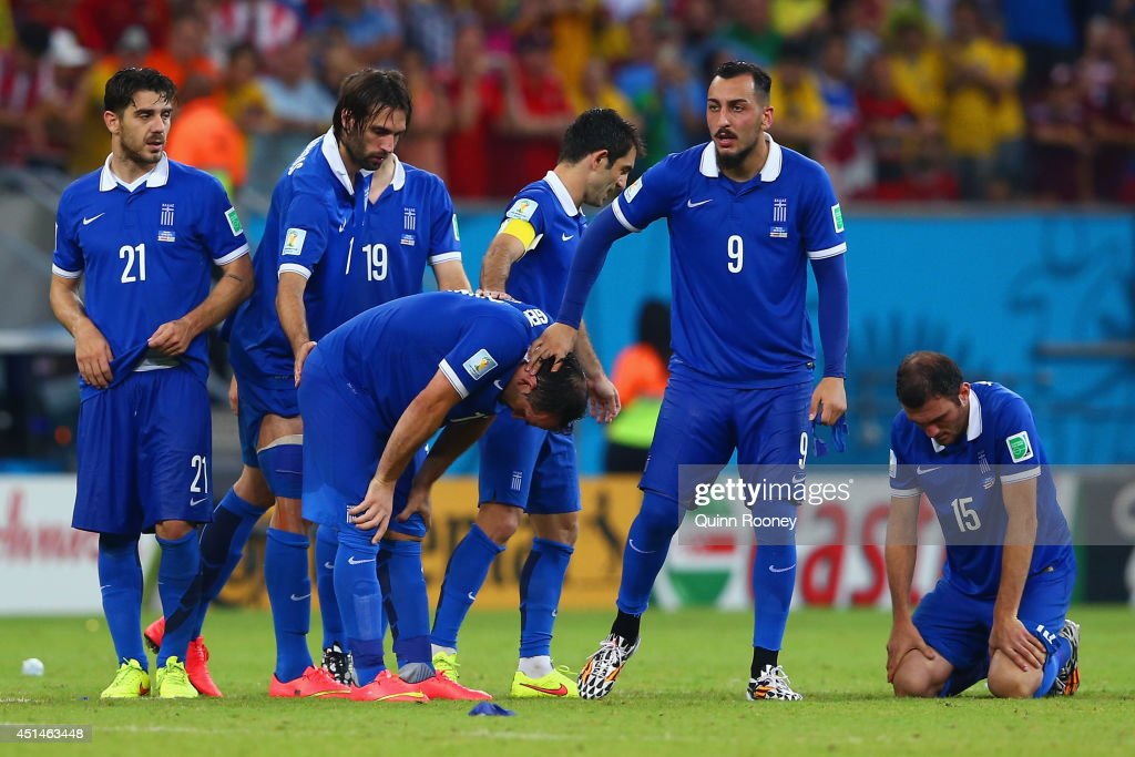 Konstantinos Katsouranis, Giorgos Samaras, Sokratis Papastathopoulos, Theofanis Gekas, Giorgos Karagounis, Konstantinos Mitroglou and Vasilis Torosidis of Greece react after being defeated by Costa Rica in a penalty shootout during the 2014 FIFA World Cup Brazil Round of 16 match between Costa Rica and Greece at Arena Pernambuco on June 29, 2014 in Recife, Brazil.