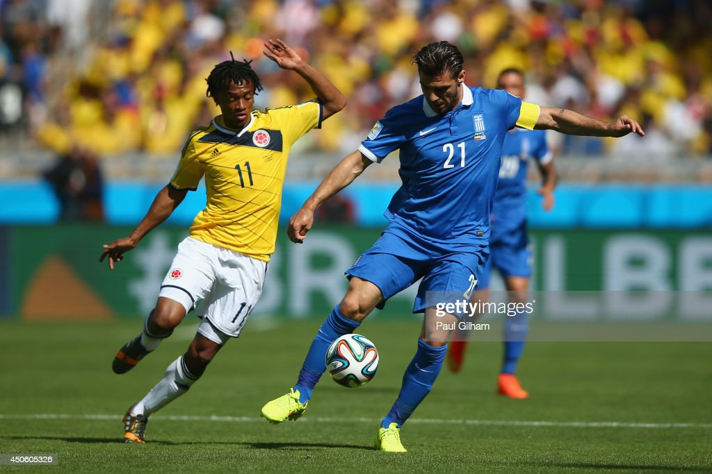 <a gi-track='captionPersonalityLinkClicked' href=/galleries/search?phrase=Konstantinos+Katsouranis&family=editorial&specificpeople=171592 ng-click='$event.stopPropagation()'>Konstantinos Katsouranis</a> of Greece controls the ball against <a gi-track='captionPersonalityLinkClicked' href=/galleries/search?phrase=Juan+Guillermo+Cuadrado&family=editorial&specificpeople=6912738 ng-click='$event.stopPropagation()'>Juan Guillermo Cuadrado</a> of Colombia during the 2014 FIFA World Cup Brazil Group C match between Colombia and Greece at Estadio Mineirao on June 14, 2014 in Belo Horizonte, Brazil.