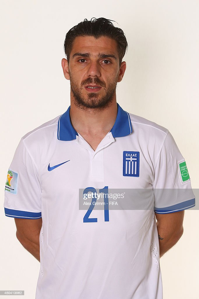 <a gi-track='captionPersonalityLinkClicked' href=/galleries/search?phrase=Konstantinos+Katsouranis&family=editorial&specificpeople=171592 ng-click='$event.stopPropagation()'>Konstantinos Katsouranis</a> of Greece poses during the official FIFA World Cup 2014 portrait session on June 10, 2014 in Aracaju, Brazil.