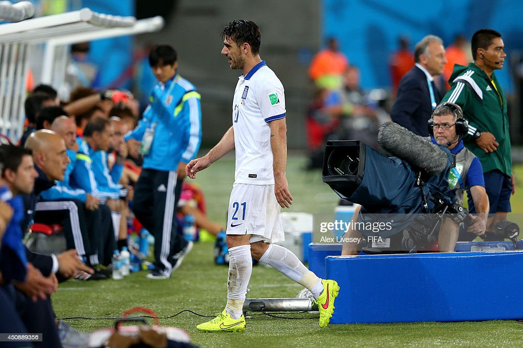Konstantinos Katsouranis of Greece walks off the pitch after receiving a red card during the 2014 FIFA World Cup Brazil Group C match between Japan and Greece at Estadio das Dunas on June 19, 2014 in Natal, Brazil.