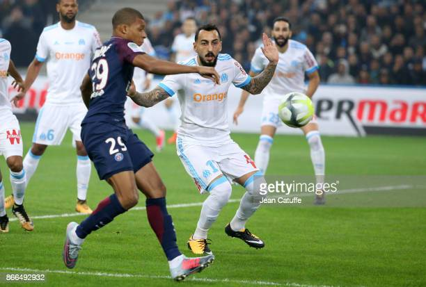 Konstantinos Kostas Mitroglou of OM and Kylian Mbappe of PSG during the French Ligue 1 match between Olympique de Marseille and Paris Saint Germain...