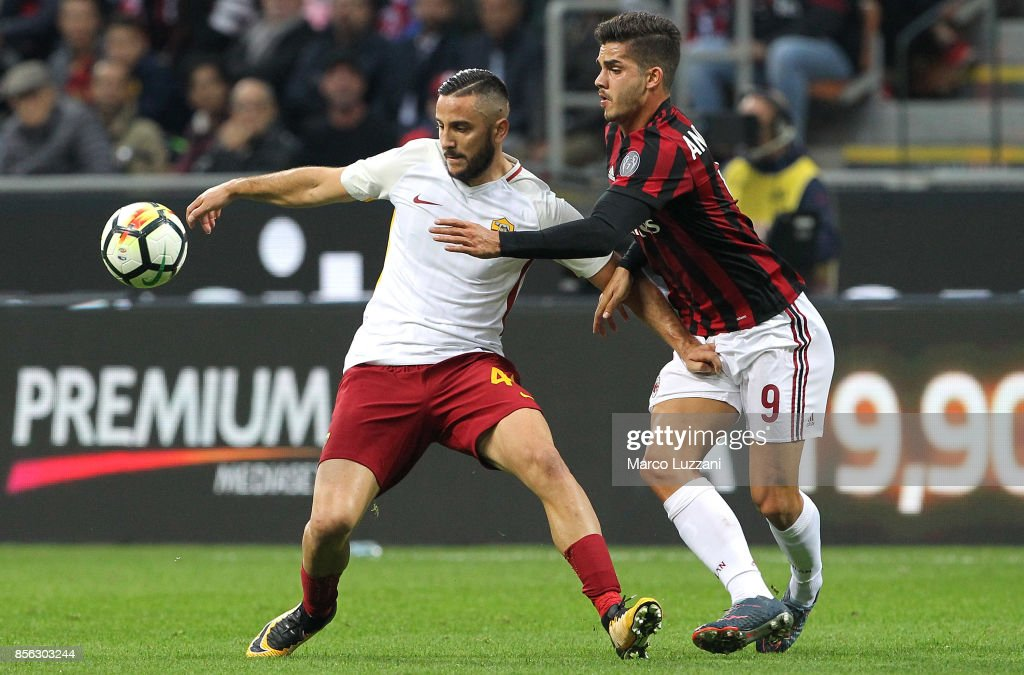 Konstantinos Manolas of AS Roma competes for the ball with Andre Silva of AC Milan during the Serie A match between AC Milan and AS Roma at Stadio Giuseppe Meazza on October 1, 2017 in Milan, Italy.