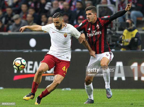 Konstantinos Manolas of AS Roma competes for the ball with Andre Silva of AC Milan during the Serie A match between AC Milan and AS Roma at Stadio...