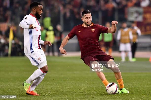 Konstantinos Manolas of AS Roma is challenged by Alexandre Lacazette of Olympique Lyonnais during the UEFA Europa League match between Roma and...