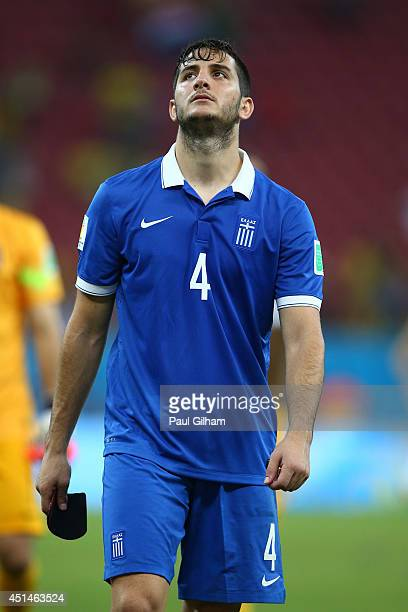 Konstantinos Manolas of Greece looks dejected after being defeated by Costa Rica in a penalty shootout during the 2014 FIFA World Cup Brazil Round of...