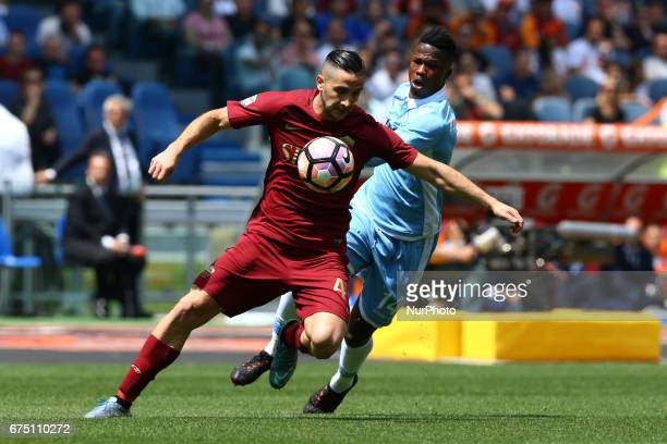 Konstantinos Manolas of Roma vies Balde Diao Keita of Lazio during the Italian Serie A football match Roma vs Lazio at the Olympic Stadium in Rome on...