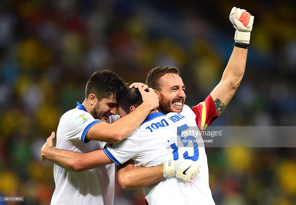 Konstantinos Manolas, <a gi-track='captionPersonalityLinkClicked' href=/galleries/search?phrase=Vasilis+Torosidis&family=editorial&specificpeople=4542702 ng-click='$event.stopPropagation()'>Vasilis Torosidis</a> and Panagiotis Glykos of Greece celebrate after defeating the Ivory Coast 2-1 during the 2014 FIFA World Cup Brazil Group C match between Greece and the Ivory Coast at Castelao on June 24, 2014 in Fortaleza, Brazil.