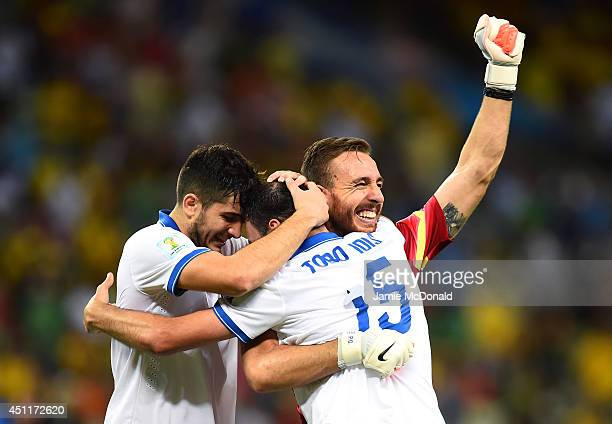 Konstantinos Manolas Vasilis Torosidis and Panagiotis Glykos of Greece celebrate after defeating the Ivory Coast 21 during the 2014 FIFA World Cup...