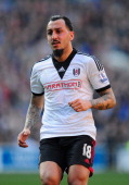 Konstantinos Mitroglou of Fulham in action during the Barclays Premier league match between Cardiff City and Fulham at Cardiff City Stadium on March...