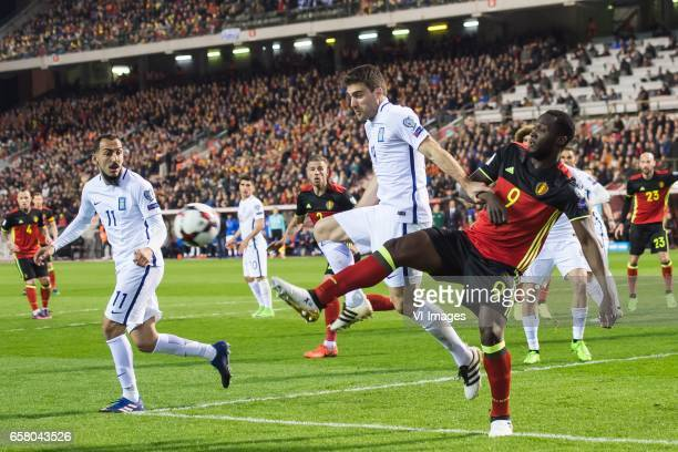 Konstantinos Mitroglou of Greece Sokratis Papastahopoulos of Greece Romelu Lukaku of Belgiumduring the FIFA World Cup 2018 qualifying match between...