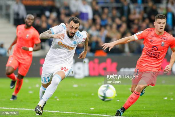 Konstantinos Mitroglou of Marseille and Frederic Guilbert of Caen during the Ligue 1 match between Olympique Marseille and SM Caen at Stade Velodrome...