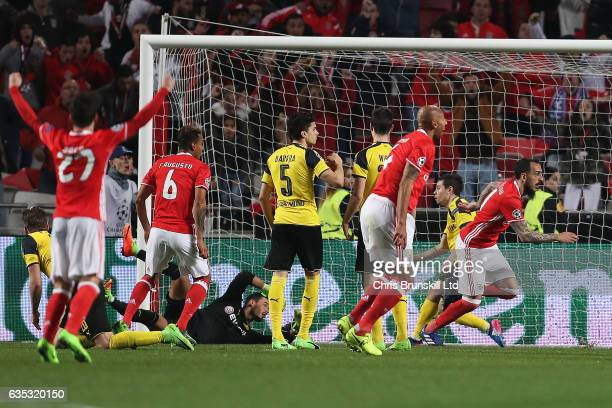Konstantinos Mitroglou of SL Benfica celebrates scoring the opening goal during the UEFA Champions League Round of 16 first leg match between SL...