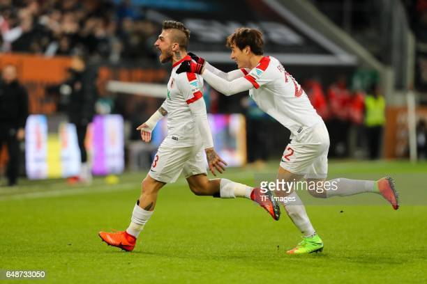 Konstantinos Stafylidis and DongWon Ji of FC Augsburg ceebrate their side's first goal during the Bundesliga match between FC Augsburg and RB Leipzig...