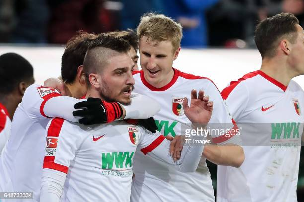 Konstantinos Stafylidis ceebrates their side's first goal during the Bundesliga match between FC Augsburg and RB Leipzig at WWK Arena on March 3 2017...