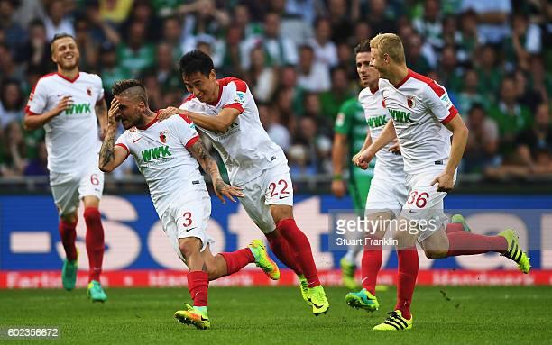 Konstantinos Stafylidis of Augsburg celebrates scoring his goal during the Bundesliga match between Werder Bremen and FC Augsburg at Weserstadion on...