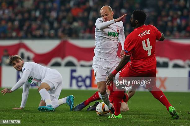 Konstantinos Stafylidis of FC Augsburg Tobias Werner of FC Augsburg and Kolo Toure of FC Liverpool battle for the ball during the UEFA Europa League...