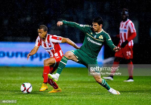 Konstantinos Triantafyllopoulos of Panathinaikos defends Mathieu Dossevi of Olympiacos during the Superleague match between Panathinaikos FC and...