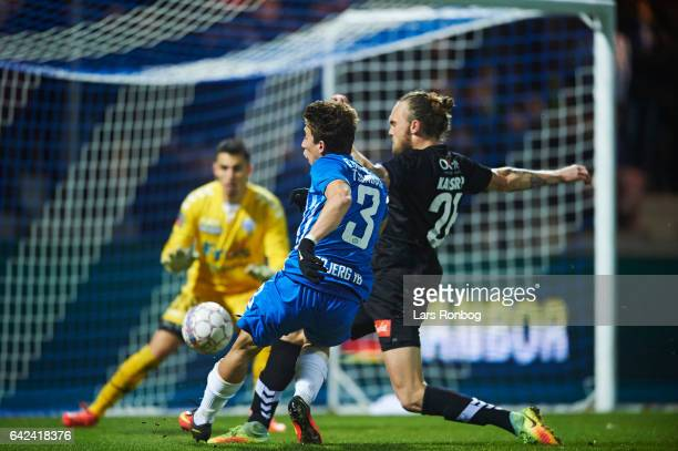 Konstantinos Tsimikas of Esbjerg fB scores the 30 goal against Pierre Kanstrup of Sonderjyske and Goalkeeper Lukas Fernandes of Sonderjyske during...