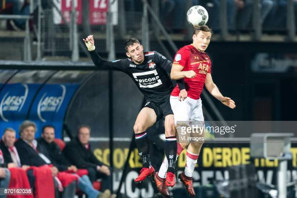 Konstantinos Tsimikas of Willem II Jonas Svensson of AZ during the Dutch Eredivisie match between AZ Alkmaar and Willem II Tilburg at AFAS stadium on...