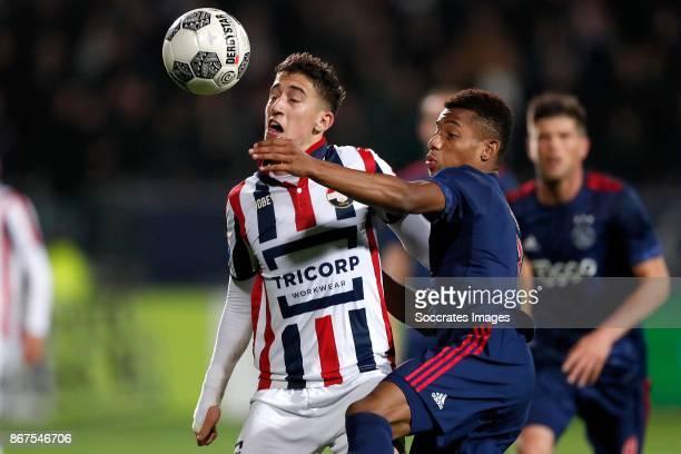 Konstantinos Tsimkas of Willem II David Neres of Ajax during the Dutch Eredivisie match between Willem II v Ajax at the Koning Willem II Stadium on...