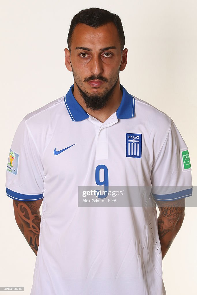 Konstatinos Mitroglou of Greece poses during the official FIFA World Cup 2014 portrait session on June 10, 2014 in Aracaju, Brazil.