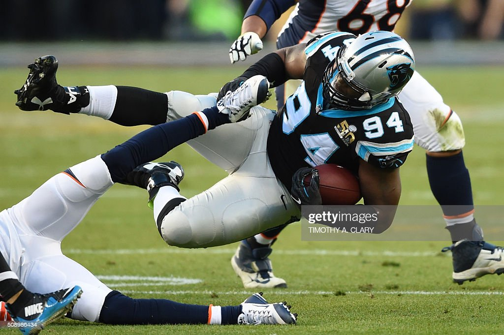 Kony Ealy (#94) of the Carolina Panthers tumbles with the ball during Super Bowl 50 against the Denver Broncos at Levi's Stadium in Santa Clara, California February 7, 2016. / AFP / TIMOTHY A. CLARY