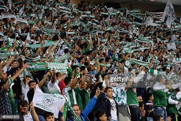 Konyaspor's fans cheer during the Europa league group H football match between Konyaspor and Shakhtar Donetsk at Konya Arena stadium in Konya on...
