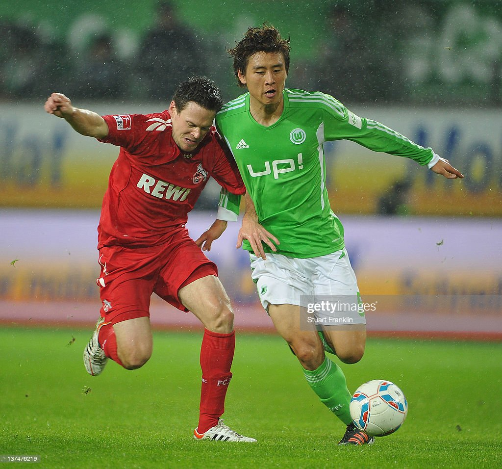 Koo Ja - Cheol of Wolfsburg is challenged by <a gi-track='captionPersonalityLinkClicked' href=/galleries/search?phrase=Sascha+Riether&family=editorial&specificpeople=614139 ng-click='$event.stopPropagation()'>Sascha Riether</a> of Koeln during the Bundesliga match between VfL Wolfsburg and 1. FC Koeln at Volkswagen Arena on January 21, 2012 in Wolfsburg, Germany.