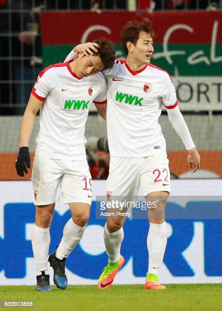 Koo JaCheol of Augsburg celebrates scoring the third goal with Ji DongWon during the Bundesliga match between FC Augsburg and Werder Bremen at WWK...