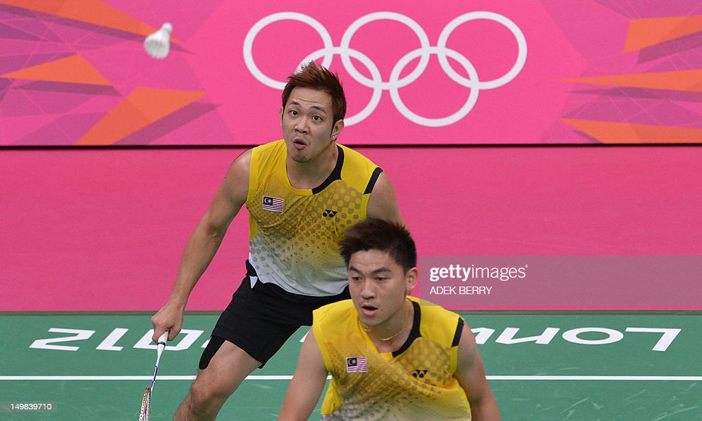 Koo Kien Keat (back) of Malaysia eyes a shuttle cock next to his partner Tan Boon Heong during the bronze medal men's doubles badminton match against South Korea's Lee Yong Dae and Chung Jae Sung at The London 2012 Olympic Games in London on August 5, 2012. South Korean won the match 23-12, 21-10.