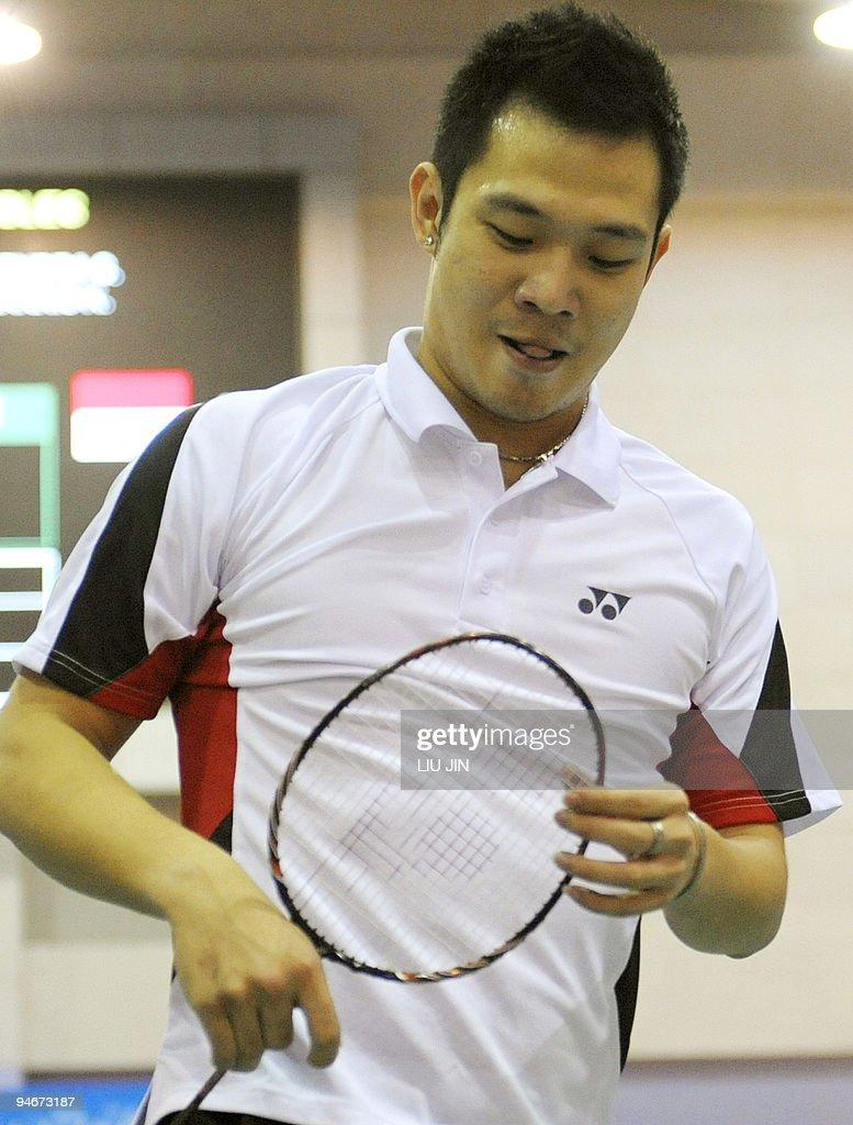 Koo Kien Keat of Malaysia looks at his b