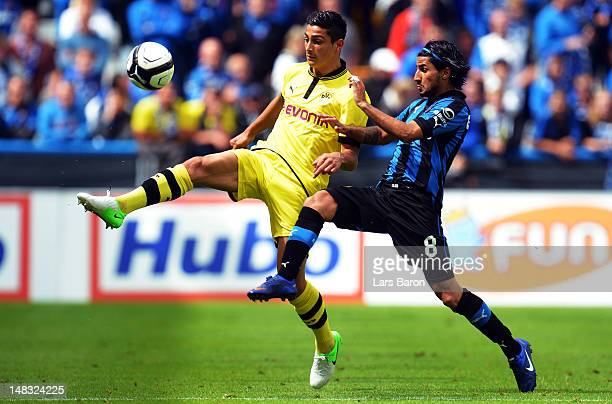 Koray Guenter of Dortmund is challenged by Lior Rafaelov of Brugge during a friendly match between Club Brugge KV and Borussia Dortmund at Jan...