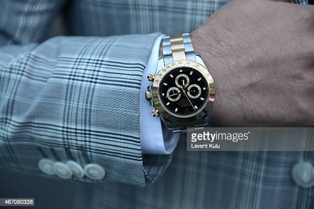 Koray Serkan Guzel poses wearing suit by Damat Tween and watch by Rolex during Mercedes Benz Fashion Week Istanbul FW15 on March 20 2015 in Istanbul...