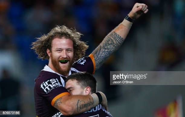 Korbin Sims of the Broncos congratulates Corey Oates on scoring a try during the round 22 NRL match between the Gold Coast Titans and the Brisbane...