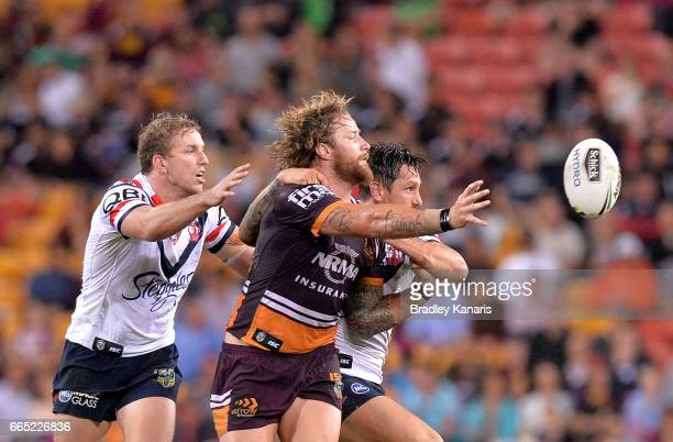 Korbin Sims of the Broncos gets a pass away during the round six NRL match between the Brisbane Broncos and the Sydney Roosters at Suncorp Stadium on...
