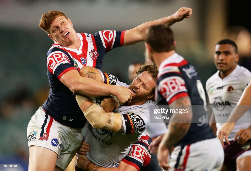 Korbin Sims of the Broncos is tackled by Dylan Napa of the Roosters during the round 13 NRL match between the Sydney Roosters and the Brisbane Broncos at Allianz Stadium on June 3, 2017 in Sydney, Australia.